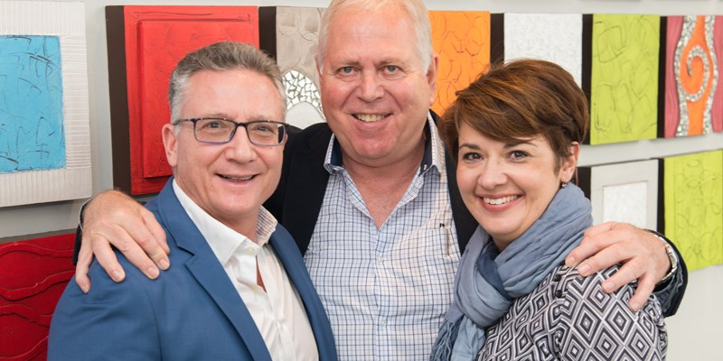 Pictured (from left) are George Argyropoulos, ceo of Cruises International; with Allan Lunz, deputy chairman and Lidia Folli, ceo of BidTravel.